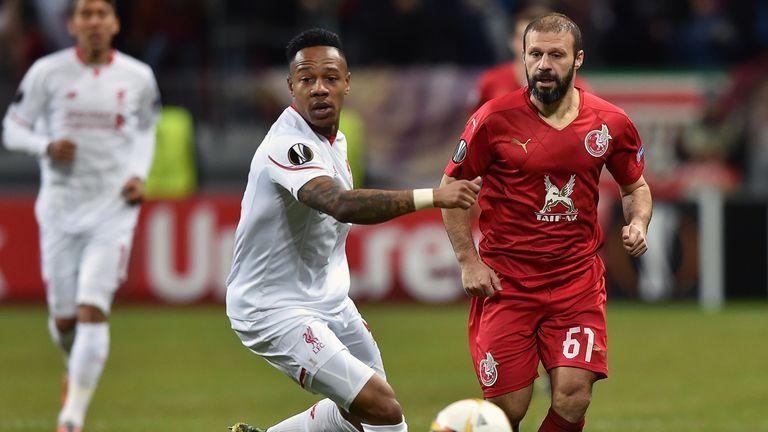Liverpool's defender Nathaniel Clyne (l) vies for the ball with Rubin Kazan's Turkish midfielder Gokdeniz Karadeniz.
