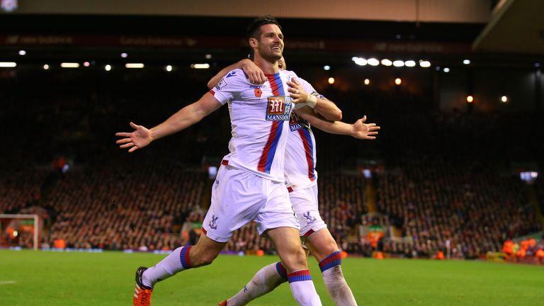 Scott Dann (L) celebrates scoring Crystal Palace's second goal against Liverpool.