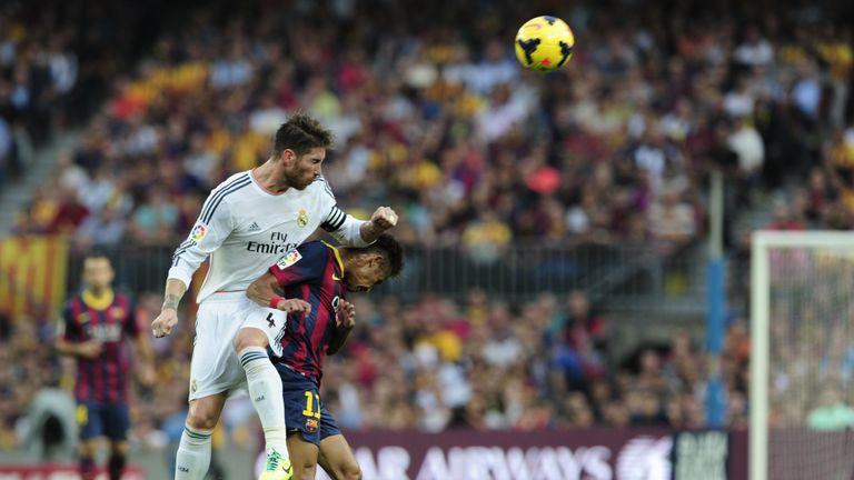 Real Madrid's defender Sergio Ramos (L) clashes with Barcelona's Brazilian forward Neymar 2003