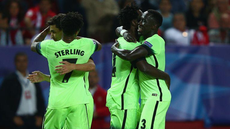 Man City players celebrate after beating Sevilla