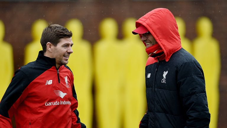 Steven Gerrard talks to Liverpool manager Jurgen Klopp during a training session at Melwood on Monday