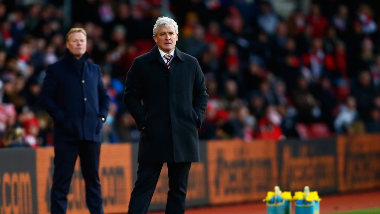 Mark Hughes, manager of Stoke City, looks on against Ronald Koeman's Southampton