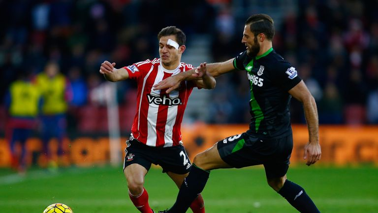 Cedric Soares of Southampton and Erik Pieters of Stoke City compete for the ball
