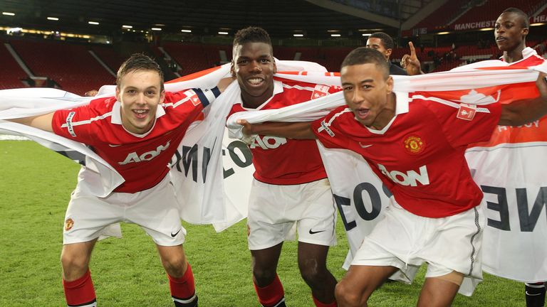 Thorpe (right) celebrates with Paul Pogba and Jesse Lingard in 2011