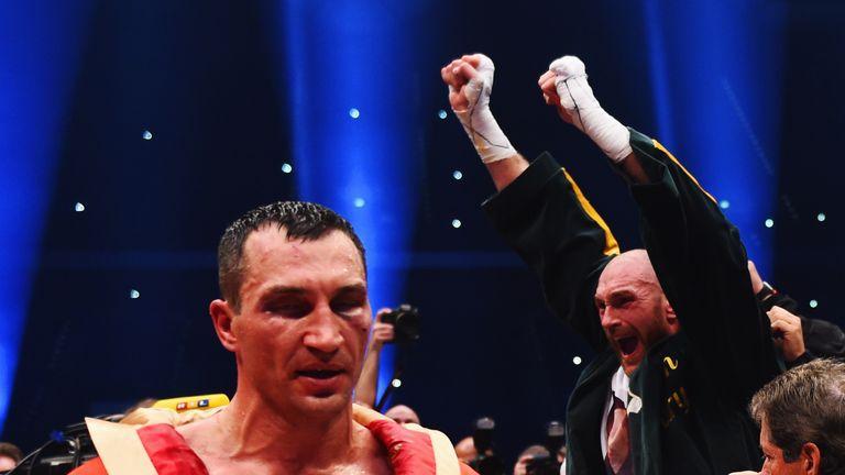 Tyson Fury celebrates after defeating Wladimir Klitschko in Dusseldorf