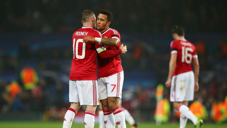 Wayne Rooney and Memphis Depay of Manchester United embrace at the final whistle during the UEFA Champions League Group match v CSKA Moscow