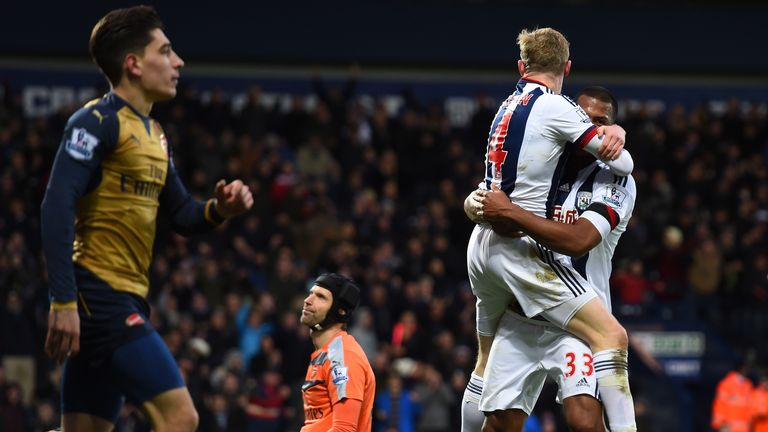 James McClean and Salomon Rondon of West Bromwich Albion celebrate after Mikel Arteta of Arsenal scores an own goal