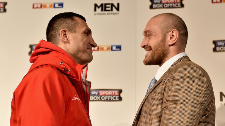 Tyson Fury and Wladimir Klitschko stare off during a press conference at Rheinterassen on November 24