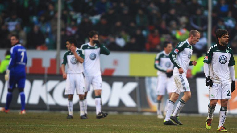 Wolfsburg players look deflated during their 3-0 Bundesliga defeat to Borussia Dortmund in January 2011