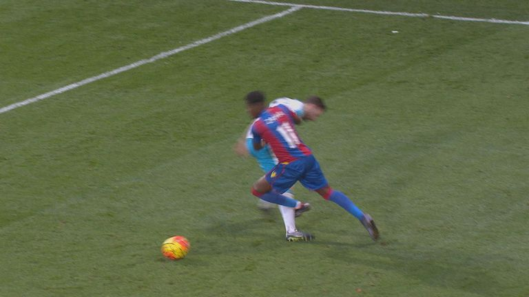 Wilfried Zaha is booked for simulation after going down under a challenge from Paul Dummett in Crystal Palace's win over Newcastle