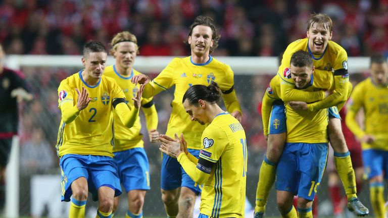 Zlatan Ibrahimovic is mobbed by his Sweden team-mates after scoring against Denmark in Copenhagen