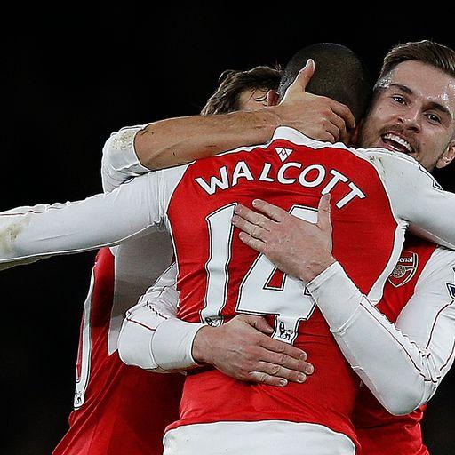 Arsenal hang on to beat City
