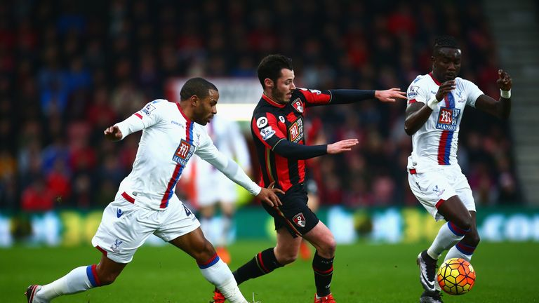Adam Smith of Bournemouth challenges Pape Souare (R) and Jason Puncheon of Crystal Palace