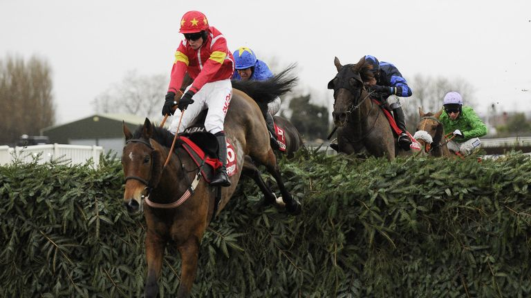 Highland Lodge and Henry Brooke jump the final fence en route to winning the Betfred Becher Chase at Aintree
