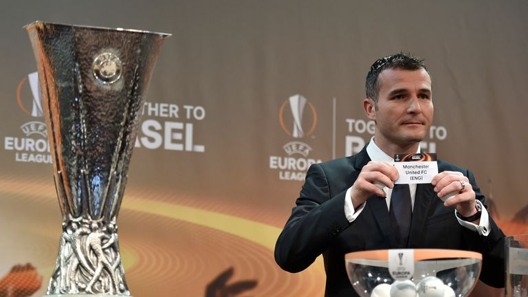 UEFA Europa League final ambassador Alexander Frei shows the name of Manchester United during the draw for  the round of 16, Nyon