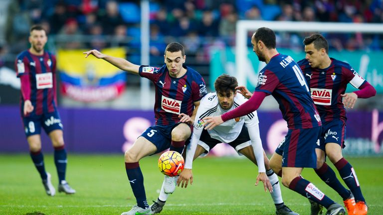 Andres Gomes of Valencia duels for the ball with Gonzalo Escalante of Eibar during the La Liga match
