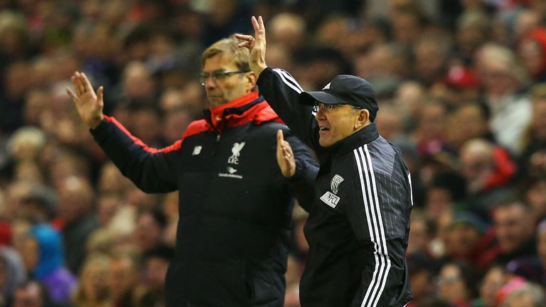 Tony Pulis and Jurgen Klopp on the touchline at Anfield
