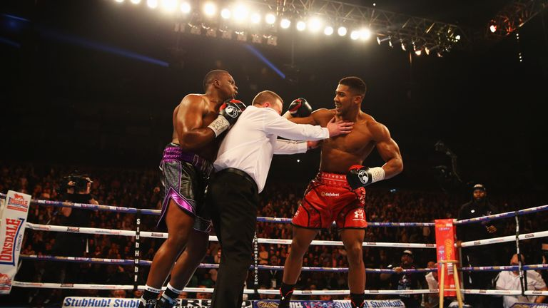 Joshua (right) and Whyte had to be held apart