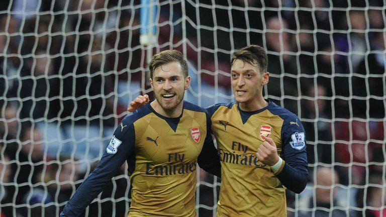 Aaron Ramsey celebrates scoring the 2nd Arsenal goal with (R) Mesut Ozil  during the Barclays Premier League match between Aston Villa and Arsenal