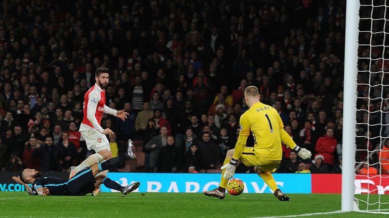 Olivier Giroud shoots past Man City goalkeeper Joe Hart to score Arsenal's second goal in first-half injury-time