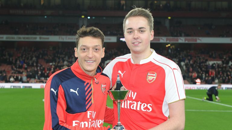 Mesut Ozil recieves the PFA Player Of The Month award