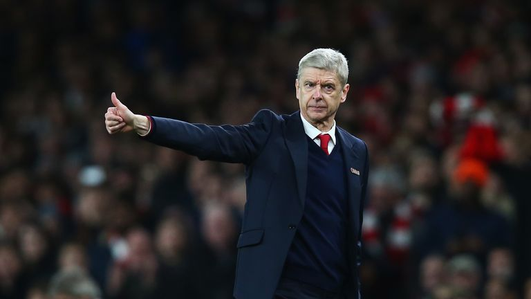 Arsene Wenger gives the thumbs up to his Arsenal team as he sees them defeat Manchester City