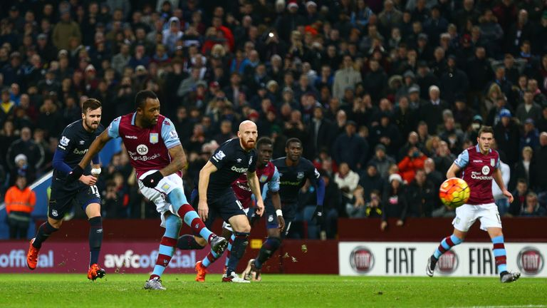 Aston Villa's Jordan Ayew scores his side's first goal from the penatly spot against West Ham