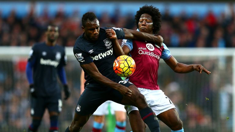 Michail Antonio battles for the ball with Carlos Sanchez