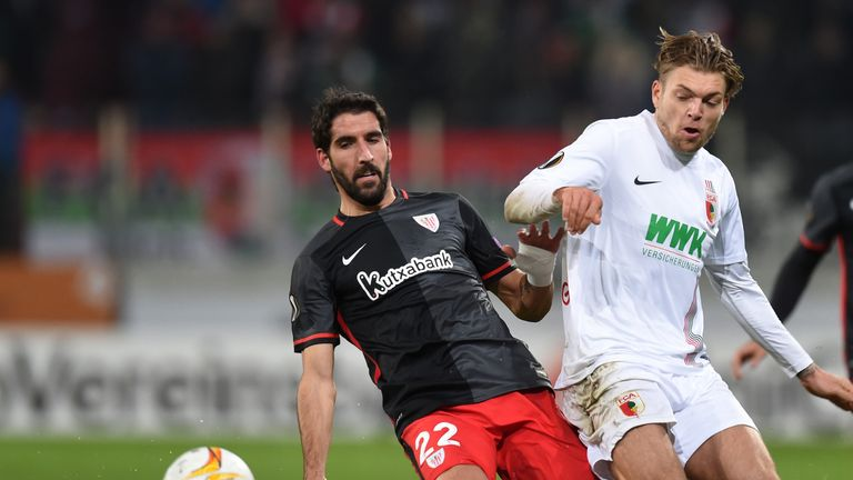 Athletic Bilbao's Raul Garcia and Augsburg's Alexander Esswein vie for the ball during the Europa League match in Augsburg in November 2015
