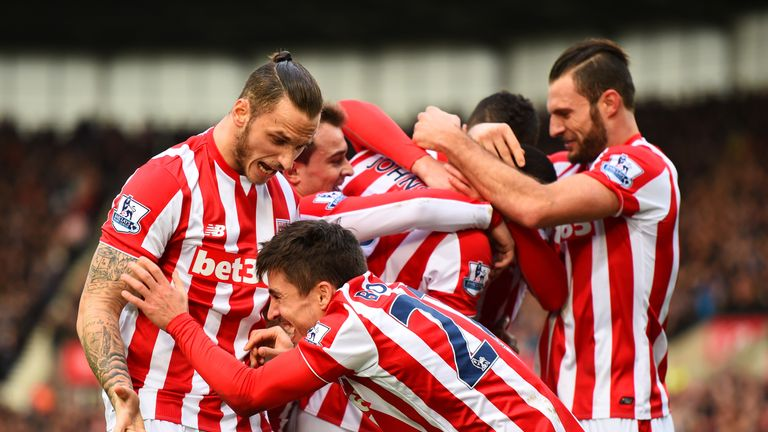 Bojan Krkic of Stoke City celebrates with team-mates after scoring the opening goal against Manchester United