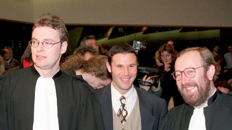Luxembourg, LUXEMBOURG:  (FILES) Belgian soccer player Jean-Marc Bosman, flanked by two of his lawyers Luc Misson (R) and Jean-Louis Dupont (L), smiles as
