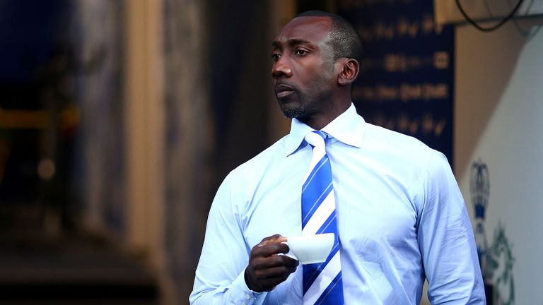 QPR manger Jimmy Floyd Hasselbaink enjoys a cup of tea before the Sky Bet Championship game with Burnley