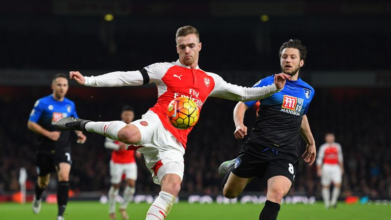 Calum Chambers of Arsenal and Harry Arter of Bournemouth compete for the ball at the Emirates