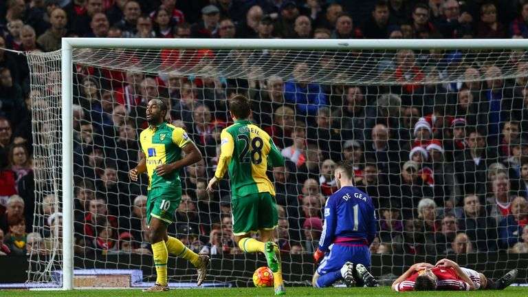 Cameron Jerome (1st L) of Norwich City celebrates