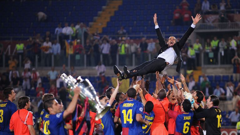 ROME - MAY 27:  Josep Guardiola coach of Barcelona is  thrown into the air by his players as they celebrate winning the UEFA Champions League Final match b