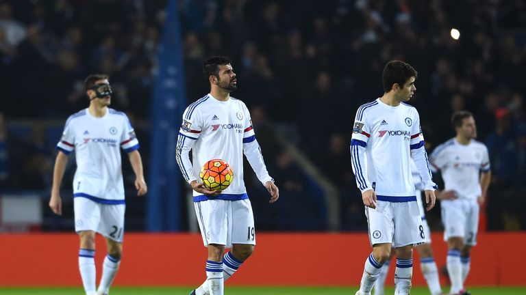Dejected Chelsea players look on after defeat to Leicester
