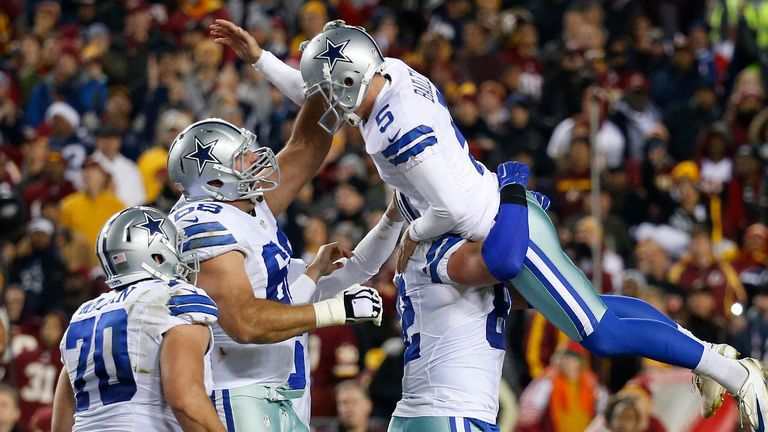 Tight end Jason Witten #82 of the Dallas Cowboys lifts up Dan Bailey #5 after Bailey kicked the game-winning field goal