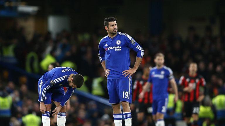 Chelsea's Belgian midfielder Eden Hazard and Chelsea's Brazilian-born Spanish striker Diego Costa (R) wait to restart the game