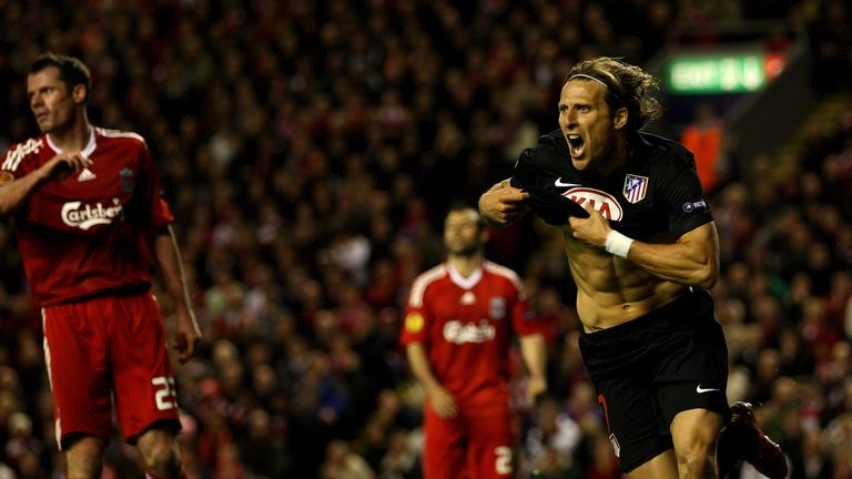 Diego Forlan celebrates scoring for Atletico Madrid against Liverpool in 2010