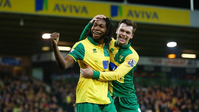 Dieumerci Mbokani (L) celebrates scores Norwich's second goal with Jonny Howson (R) during the Barclays Premier League match against Aston Villa