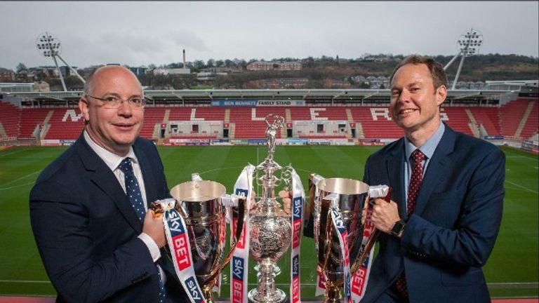 Football League chief executive Shaun Harvey and Sky Bet chief executive Richard Flint with the Football League's three trophies