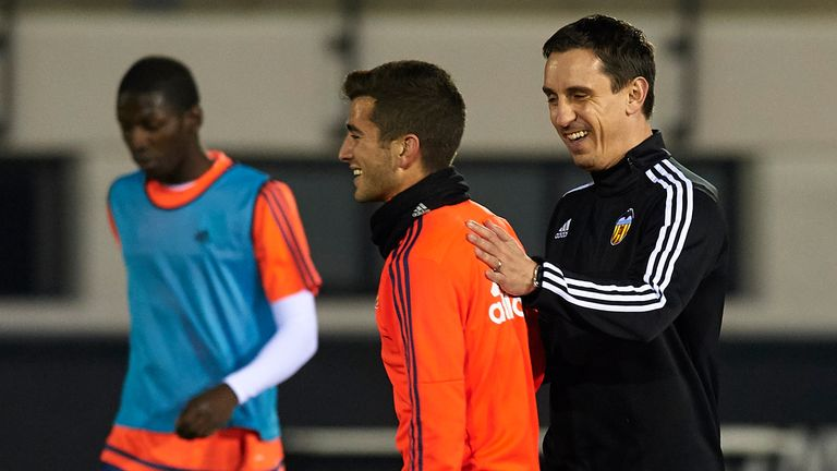 VALENCIA, SPAIN - DECEMBER 07:  Gary Neville (R) the new manager of Valencia CF reacts to his player Jose Gaya during a training session ahead of Wednesday