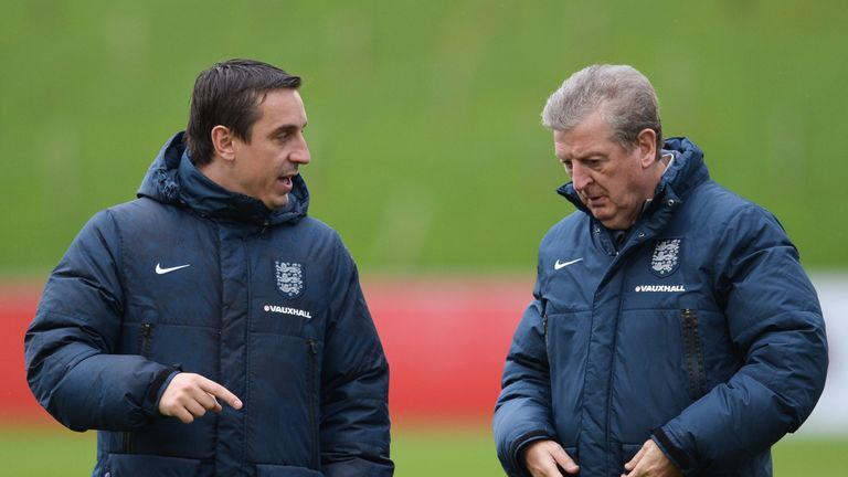 BURTON-UPON-TRENT, ENGLAND - NOVEMBER 14:  Roy Hodgson manager of England (R) and coach Gary Neville in discussion during an England training session, ahea