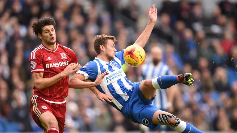 Middlesbrough's George Friend (left) and Brighton's James Wilson battle for the ball