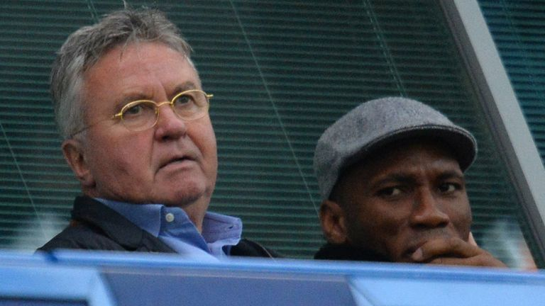 Chelsea's new interim manager Guus Hiddink (left) and former player Didier Drogba