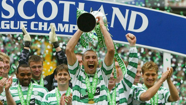 Celtic's Henrik Larsson celebrates with the trophy