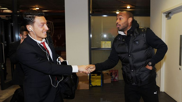 Arsenal's Mesut Ozil and Thierry Henry