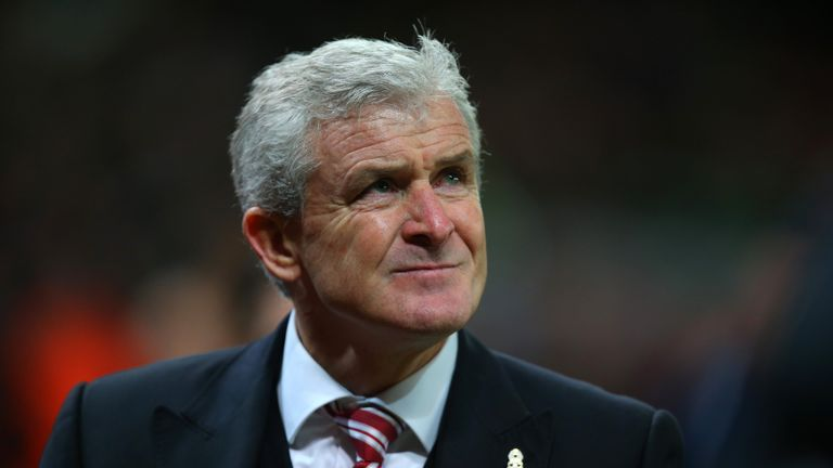 Stoke City Mark Hughes looks on following his sides victory during the Capital One Cup match between Stoke