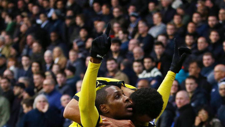 Odion Ighalo (R) of Watford celebrates scoring his team's first goal with his team mate Ikechi Anya (L) during the games against Tottenham