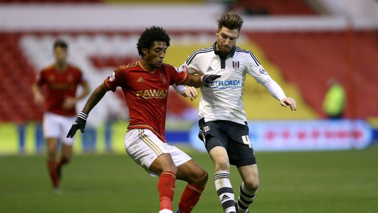 Fulham's James Husband (right) and Nottingham Forest's Ryan Mendes battle for the ball